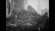 Crowd cheering for French soldiers at parade Stock Footage