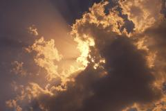 Sunset sun  sky and clouds Stock Photos