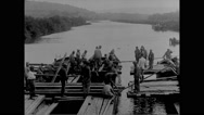Military soldiers constructing pontoon bridge Stock Footage