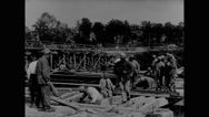 Military soldiers constructing pontoon bridge Stock Footage