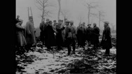 Military officers and soldiers paying tribute at cemetery Stock Footage