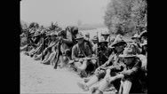 Military troops resting on grass Stock Footage