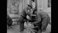 Military soldiers cleaning 37-mm guns Stock Footage
