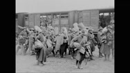 Military soldiers getting off from train and walking Stock Footage