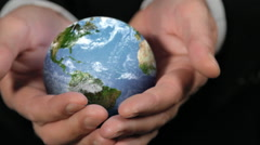 ROTATING CLOSE EARTH GLOBE IN HANDS Stock Footage