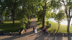 Newlyweds running in the park Stock Footage