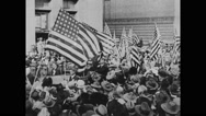 President Theodore Roosevelt waving at people while passing through crowd Stock Footage