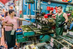 people shopping seafood market causeway bay hong kong - stock photo