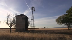 Tranquil pump house and windmill - stock footage