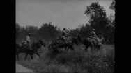 Damaged houses in Lassigny and military soldiers riding artillery caisson Stock Footage