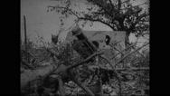 Military soldier examining German artillery Stock Footage