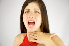 Woman left without voice unable to talk Stock Photos