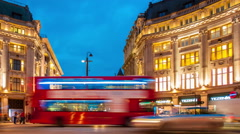 Timelapse - Oxford Circus in London at dusk with panning Stock Footage