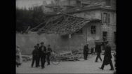 People standing in front of damaged buildings Stock Footage
