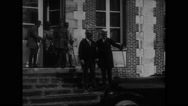 Cabinet members and Marshal Ferdinand Foch getting into a car Stock Footage