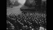 Military soldiers marching on street while in parade Stock Footage