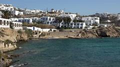 Mykonos Greece white homes above ocean cliff 4K 155 Stock Footage