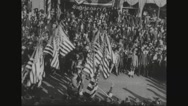 Military soldiers marching on street with American flag Stock Footage