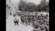Military soldiers marching in Saint Nazaire Stock Footage