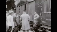 Military officers greeting General John J. Pershing at railway station Stock Footage