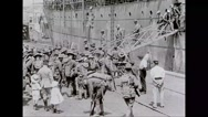 Military soldiers debarking from battleship Stock Footage