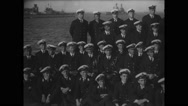 Sailors sitting on harbour Stock Footage