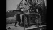 Troop loading railroad gun Stock Footage