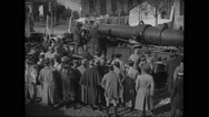 Troop loading railroad gun Stock Footage