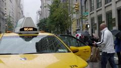 Taxi Cab Raining Tourism Tourist Manhattan 5th Ave New York City Slow Motion 4K Stock Footage
