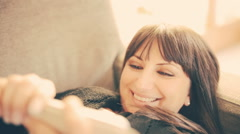Woman watching a funny video on smartphone Stock Footage
