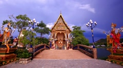 Koh Samui. Thailand 20 july 2014.  Women pray at Buddhist pagoda, part of temple Stock Footage