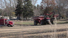 Farm Tractor maneuvering trailer Stock Footage