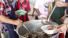 Orphans living in Temple getting free lunch from Philanthropists. Stock Footage