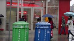 Manhattan Raining People Walking NYC Umbrellas New York City Slow Motion 4K Stock Footage