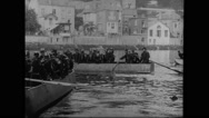 Military soldiers rowing boat at banks of Meuse Stock Footage