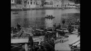 French soldiers launching and rowing boat at banks of Meuse Stock Footage