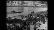 Military soldiers working and loading wood in boat near banks of Meuse Stock Footage
