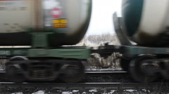 A passing train with oil tanks Stock Footage