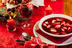 traditional christmas red borscht with meat filled dumplings - stock photo