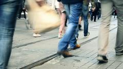 Legs of walking people on stone and car free road at Istanbul  Stock Footage