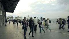 Young crowd crowded walking  commuter, pedestrian pier harbor port Stock Footage