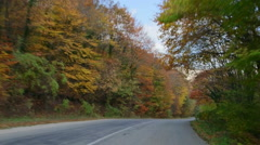 Driving car on mountain road through fall foliage - stock footage