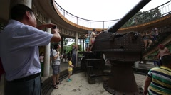People Playing on old Cannon in Nanning, China Stock Footage