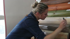 Woman paints the wood with protective lacquer Stock Footage