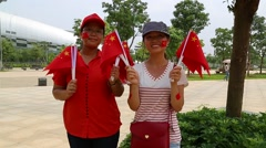 Women With Flags Outside Sporting Event Stock Footage