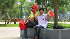 Men With Chinese Flags Outside Sporting Event - stock footage