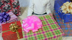 Little girl opening large gift box with white soft toy Stock Footage