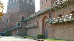 Frombork Poland. Bell tower and medieval walls surrounding catholic cathedral Stock Footage
