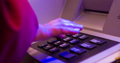 Night time Entering pin number at ATM 4k Stock Footage
