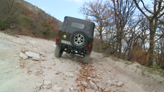 Off road driving on stony mountain track to Mangup Stock Footage